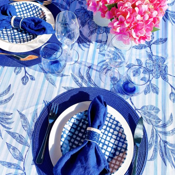 blue tablescape tablecloth and pink flowers