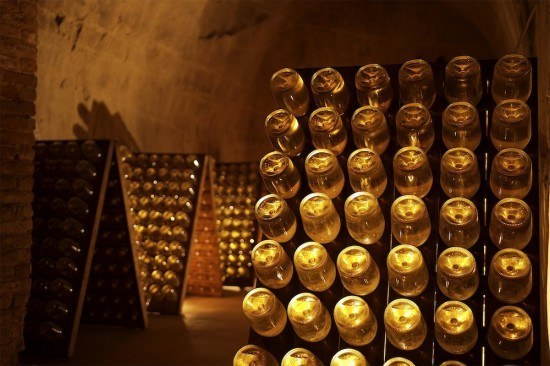 Bottles of champagne mature slowly and gracefully in the cool chalk cellars deep underground