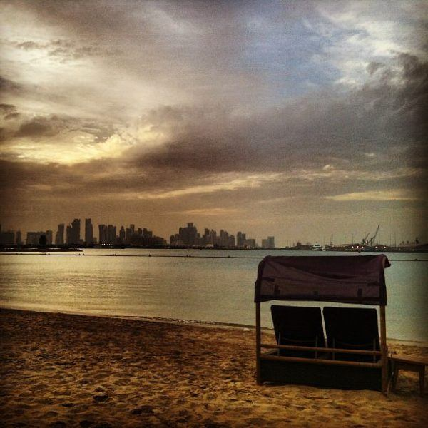 sunset in doha seen for the Sharq ritz Carlton luxury hotel